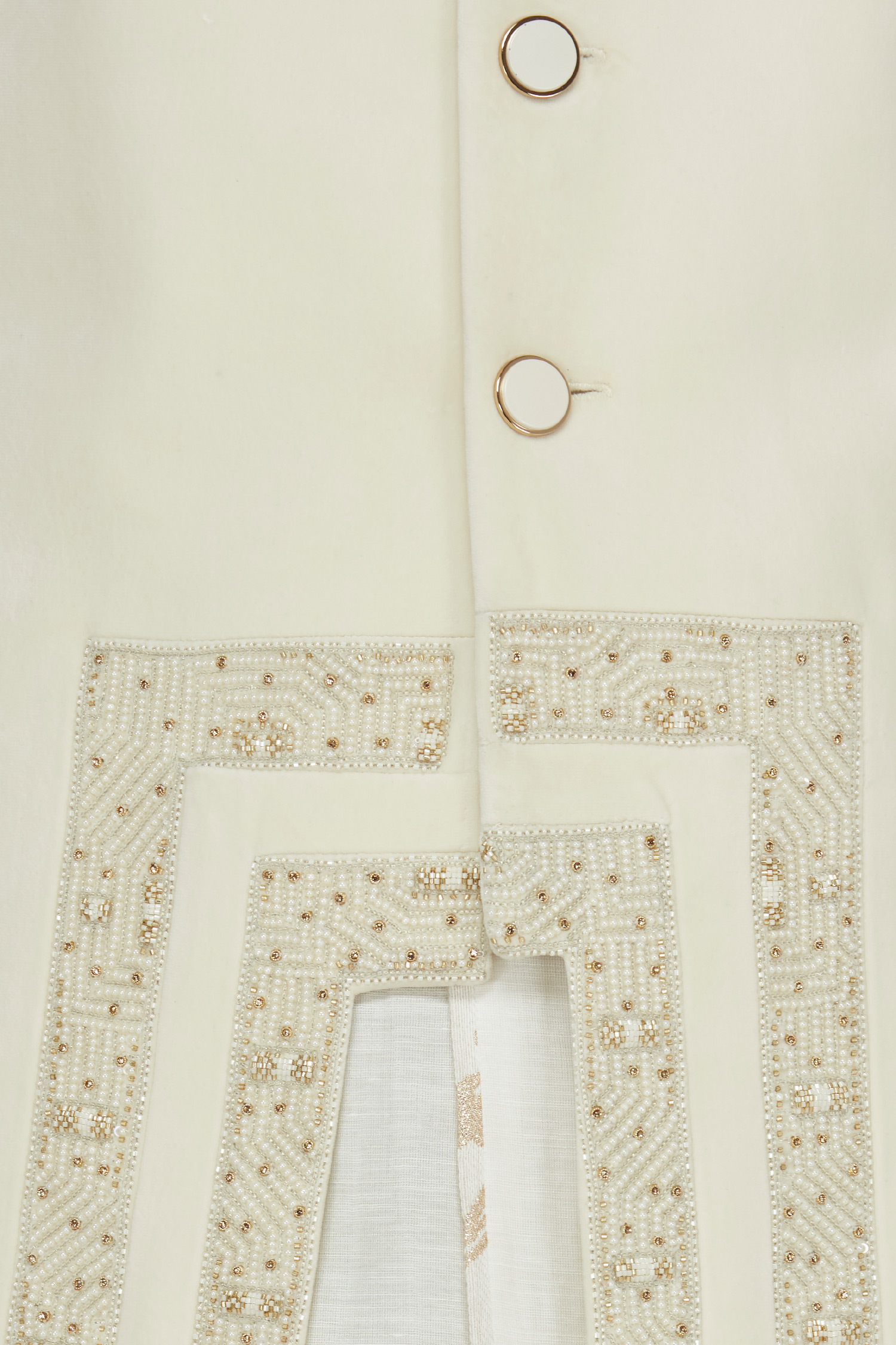 White sherwani ensemble designed by Prima Czar at AASHNI+CO